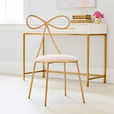 How posh! This golden desk chair's back is formed into a sweet bow to bring playfully glamorous style to your space. With a pastel cushion, it's distinctly Parisian. Imagined exclusively for PBteen by celebrity stylists and fash Desk Chair Teen, Teen Desk, Gold Bedroom Decor, Emily And Meritt, Pottery Barn Teen, Teen Girl Bedrooms, New Room, Girl Room, Decoration