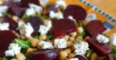 The vibrant jewel-toned colours of magenta beets, golden chickpeas, bright green arugula and tangy herbed goat cheese play of...