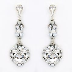 Justine M Couture Bridal Jewelry. Sparkling bridal earrings of delicate clusters of crystals finished with a large cushion cut pear drop.