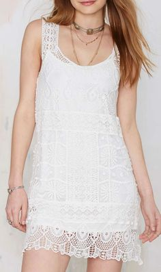 White Crochet Dress - Features delicate crochet, a scalloped hem, slip dress lining, and a shift silhouette. LOVE this dress!