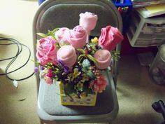baby sock flower arrangement with a few wash cloth flowers for baby shower