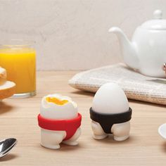 Sumo Eggs - Egg Cups - With this pair of red and black sumo egg holders, you can start a little-but-tasty food fight of your own. And remember, the winner breaks it all!