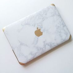 Marble + gold laptop case.