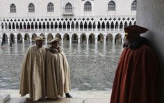 Masked revellers pose along the flooded St. Mark's Square during a period of seasonal high water and on the first day of carnival, in Venice, Italy. Perfectly Timed Photos, New Life, Kai, Carnival, February 1, Weather, Poses, Seasons, Venice Italy