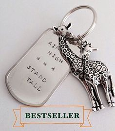 Stand Tall Giraffe Hand-stamped Stainless Steel Keychain. Inspire yourself to stand tall and aim high with this metal keychain, complete with choice of bling giraffe or mom & baby giraffe charm. Item can be personalized with an additional small, flat, silver charm. Space is limited. To order, please chose the personalization option and add your personalization request to the notes. I will email you back to confirm what the final charm will say and look like. ***Due to the nature of the…