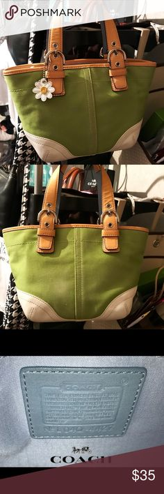"""COACH 4427 Small Daisy Hobo Canvas/Leather Cute double strapped hobo with zip top closure. Zip and slip pockets interior featuring blue canvas lining. Outer is spring green canvas with white leather bottom. Barely noticeable blemish on Back—see last pic (it's just a tad lighter than the rest) great bag for casual days and comfortable evenings 100% Authentic. Measures 12"""" x 7"""" x 3"""" with 5"""" handle drop Coach Bags Totes"""