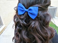 curly hair with blue bow