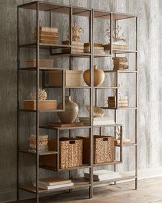 Using an open Etagere in a living room is a stylish and modern way to display and store items. They look much more sleek than built ins. Just be sure you mount a piece like this to the wall!