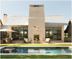 You can almost feel the sun just looking at this space by V Fine Homes in Fort Worth. The clean lines and pared down palette of the house and landscape make the area feel sophisticated and calm—a perfect setting for evening cocktails or enjoying a cool dip.