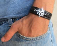 "Men's Bracelet - Men's Compass Bracelet - Men's Black Bracelet - Mens Jewelry - Bracelets For Men - Jewelry For Men - Gift for Him  Looking for a gift for your man? You've found the perfect item for this!   The simple and beautiful bracelet combines black Fabric strip that wrap 3 times on hand and silver plated compass pendant.  Bracelet Length: 22.8"" (53 cm ). Comes with a 2"" (5 cm) extension chain. $27"