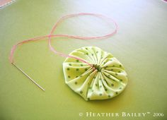 Longer stitches will allow the fabric to gather together more closely.  center of yoyo is to show