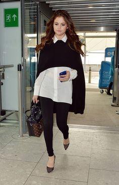 Selena Gomez wears a black cape, Alice + Olivia shirt, black leggings, a Louis Vuitton bag, and Soebedar Black Mesh Pumps