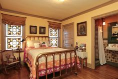 2nd Master Bedroom Suite features custom stained glass windows from John Joy Art Glass Studios and hardwood floors.