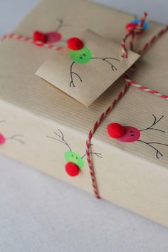 reindeer gift package using circle stamp (or marker) and pom pons.