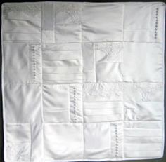 "A smaller version of our Classic Wedding Dress Quilt. Pattern will be a simple 6-inch block to showcase your dress material. Finished quilt approx 36""x36"". Reverses to white muslin.%0D%0A%0D%0A%09Turn your wedding dress into a beautiful handmade quilt! Your dress will be pieced with parts of your dress, veil and/or train to create a keepsake quilt that can be cherished for years to come. Don't leave your dress in a box- display it in a quilt! Reverses to 100% white cotton…"