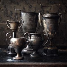 Father's Day still life with vintage trophies including a 1927 prize for Best…