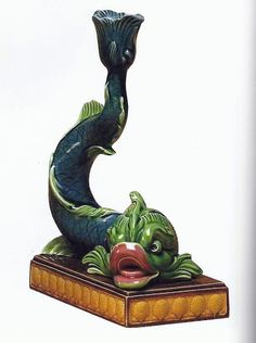 Majolica dolphin candlestick, c1870. Wedgwood candlesticks of this form also appear in black basaltes and Queen's ware. They are believed to have been originally moldeled by Josiah I.