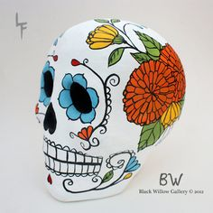 paper mache skull, custom made, guests may sign around the design.