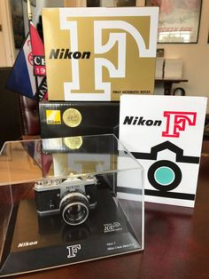It was delivered yesterday, my superb 100th Anniversary Miniature Nikon F camera + 50mm f/1.4 Nikkor-S Auto lens, in transparent display box plus a reproduction of the original instruction manual and maker's box. Perfect! - Gray Levett