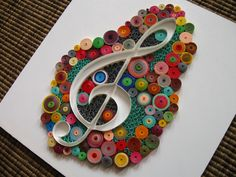 Quilled G clef on a white panel (the panel is 16.5x16.5 cm)