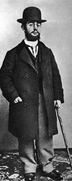 Full-length portrait of French artist Henri Toulouse-Lautrec wearing an overcoat, a bowler hat, and pince-nez eyeglasses while holding a cane. (Photo by Hulton Archive/Getty Images). Circa 1895
