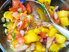 "This salsa (inspired by Costco's Santa Barbara Mango Peach Salsa) is easy, delicious & has a little ""kick""."