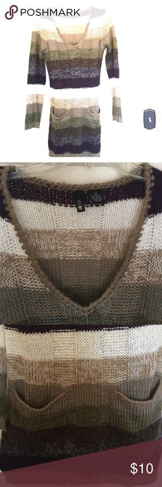 Sweater Dress Warm and cozy sweater dress. 2 front pockets. Purple, green, white and beige. Great with leggings. Was a gift, worn once. Ultra Flirt Dresses