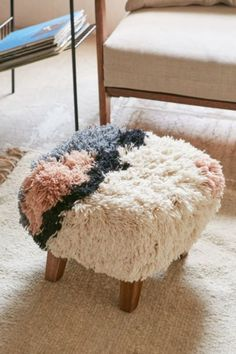 Magical Thinking Shaggy Ottoman - Urban Outfitters. Would be great for my dog :)