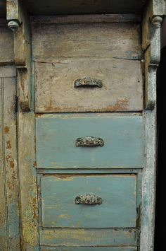Unusual cabinet with bead board, corbels with finials