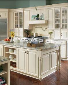 kitchen island - white cabinets, lighter granite countertop