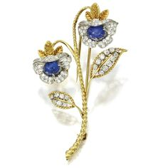 18 KARAT GOLD, PLATINUM, SAPPHIRE AND DIAMOND FLOWER BROOCH, VAN CLEEF & ARPELS, NEW YORK, 1958 Set with cabochon sapphires weighing approximately 2.90 carats, and round and single-cut diamonds weighing approximately 1.30 carats,