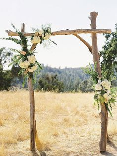 Driftwood ceremony arch for an outdoor wedding