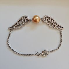 Harry Potter Golden Snitch Bracelet • Free tutorial with pictures on how to make a charm bracelet in under 20 minutes #howto #tutorial