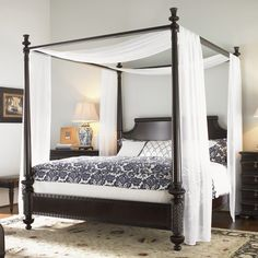 "Features:  -Removable canopy frame.  -Posts break for low post option.  -Constructed of mahogany veneers and select hardwoods.  -Distressed in coffee finish.  -Bed Height: 59.25"".  Distressed: -Yes."