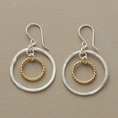 """Braided rings of 14kt gold vermeil create a stir within the confines of brushed sterling silver hoops. French hook. USA. 1-1/2""""L."""