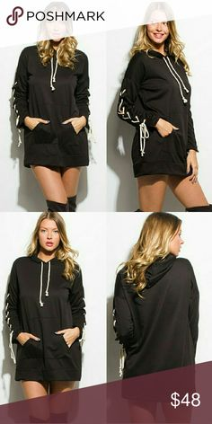 """SALE♡Lace Up Hoodie Dress/Tunic Top Sporty, comfy, and sexy! You will want to live in this black hooded, long sleeve top that doubles as a mini dress. Kangaroo front pocket. Banded bottom. White lace up details on arms. Super fun. Get yours now!  65% polyester, 35% cotton. Made in USA. Small = Length 30.5"""", Bust 42"""" (size 2-4) Medium = Length 31"""", Bust 43"""" (size 6-8) Large = Length 31.5"""", Bust 44"""" (size 10-12) Line 6ix Tops"""