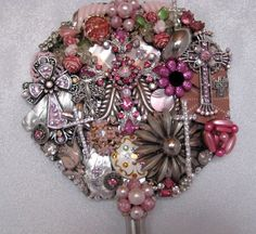 This one would be easy, basic hand mirror, glue, old vintage and costumne jewelry and what a pretty addition to your vanity top.