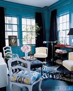 I love the drama of this magazine room. They served up lots of peacock blue, heavy doses of white to lighten it up, and black accents to make it dramatic. Love that zebra rug – it adds some levity to a formal room. Le Living, Teal Living Rooms, Blue Rooms, Blue Walls, My Living Room, Living Spaces, Peacock Room, Peacock Blue, Peacock Colors