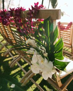 Tropical wedding ceremony chair flowers - outdoor wedding at Andaz Maui - Country Bouquets Maui - Anna Kim Photography