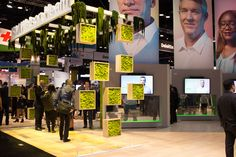 I.B.M.: I.B.M. used real moss in 18- by 18-inch hanging boxes and draped from trellises to create a unique frame for its large booth. A spokesperson said the design is intended evoke a feeling of life and health. The booth also has large photos of I.B.M. clients and partners displayed atop touch-screen monitors showing videos from those people talking about how they have benefited from I.B.M.'s health technologies. The booth was designed in partnership with agencies George P. Johnson and…