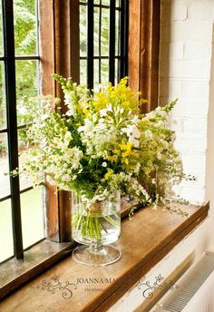 Summer wedding flowers, delicate meadow flowers: aster, anthurihnum, agapanthus, solidago, tanacetum, ammi. Garden, rustic, hand picked flowers for wedding.