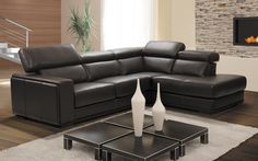 Sectional Maggy - Contemporary Style - Platinum Collection. Dark brown leather sectional with adjustable headrest.