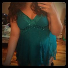 PARTY SALE‼️🎉Blue-green Ribbon Sleeve Tank Top Super cute beaded, lace and sleeve detail. Fitted, but not tight tank with, flowy overlay from chest down. Flattering v-neck. Zipper on side, but I was able to put it put it on with ease without undoing the zipper. Size large. New York & Company Tops Tank Tops