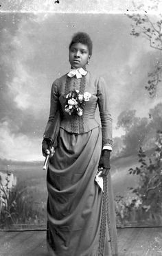 African American women with parisol and fan by Black History Album, via Flickr