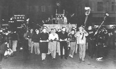 The 1938 homecoming noise rally parade through Eugene.  From the 1939 Oregana (University of Oregon yearbook).  www.CampusAttic.com