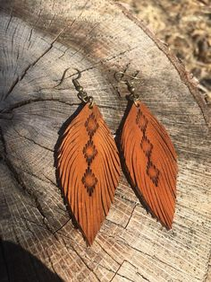"""These hand made """"Mini Tribal"""" leather feather earrings are my latest design and most Popular! The first picture listed is """"Tanned Hide,"""" the third picture is """"Creamy Vanilla,"""" the fourth picture is """"Rustic Black,"""" and the fifth picture is """"scarlet red."""" Pick out what color you"""