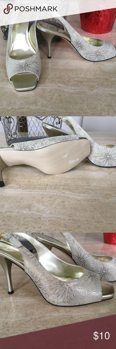 Anne Klein shoe - never worn New, never worn! Off white with silver and gold/copper flower design.  Heel 4 inch Anne Klein Shoes Heels