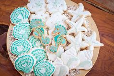 gorgeous shell, starfish, sand dollar and seahorse (wedding favor) cookies in white and turquoise