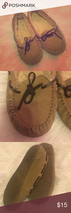 Tan & Brown moccasins. Tan moccasins with brown straps. Slightly worn, but still in good condition. Soles of the shoes are clean. Shoes Moccasins