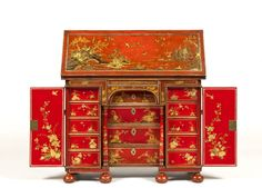 The Houghton Hall Red Lacquer Bachelor's Chest A Queen Anne scarlet and gilt japanned Bachelor's chest or writing desk. Having a hinged rectangular top finely decorated with a chinoiserie landscape of pagodas, trees, figures on horseback and birds and insects within a silvered border.